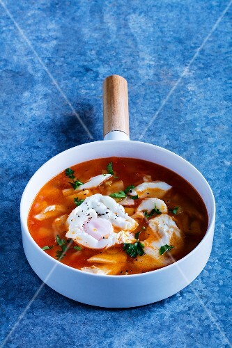 Cod soup with poached eggs