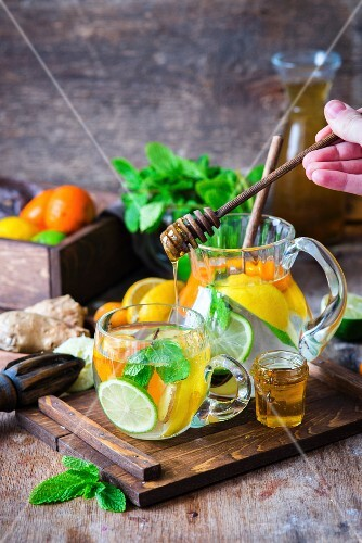 Detox water with citrus fruits, ginger and honey