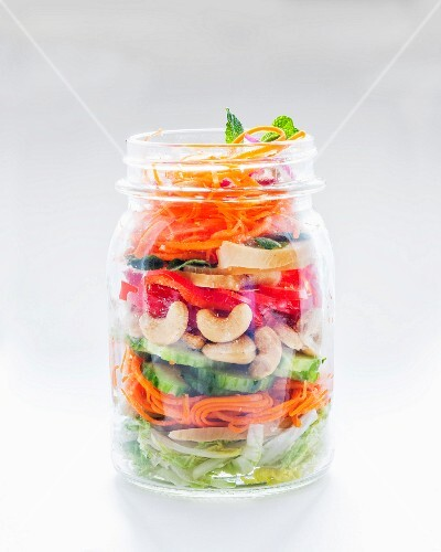 Vegetable salad with cashew nuts in a glass jar