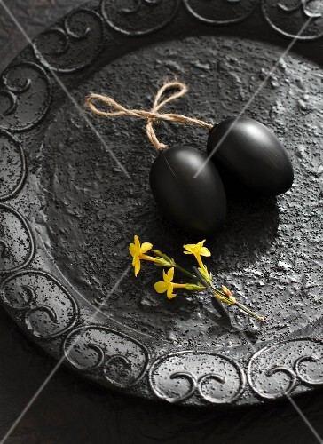 Black plastic eggs on a tray as a decoration for Easter