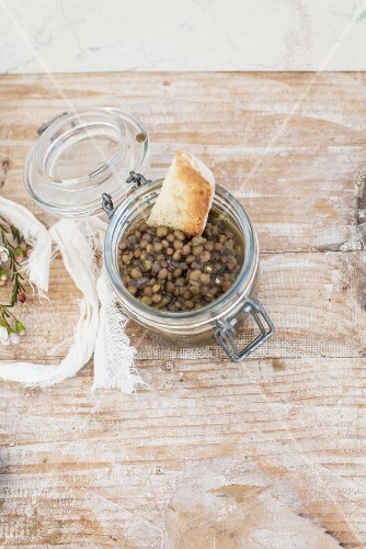 Lentil salad in a glass with toasted bread