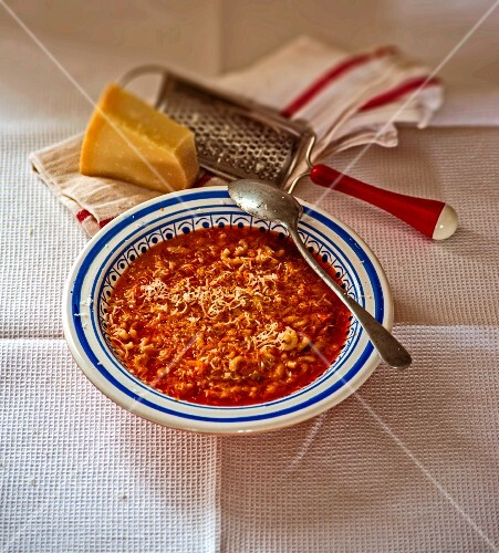 Pasta e fagioli (bean soup with noodles, Italy) topped with parmesan