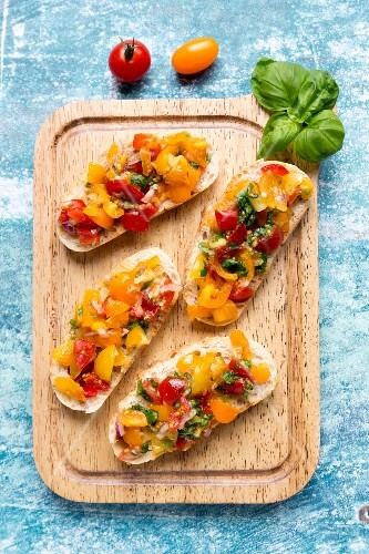 Bruschetta with colourful tomatoes and basil