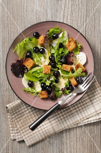 Lettuce with goat's cheese, olives and croutons (Pyrenees, France)