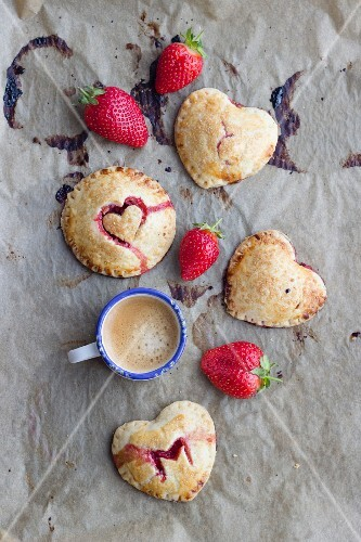 Hand pies (mini pies) with a strawberry filling and heart decorations