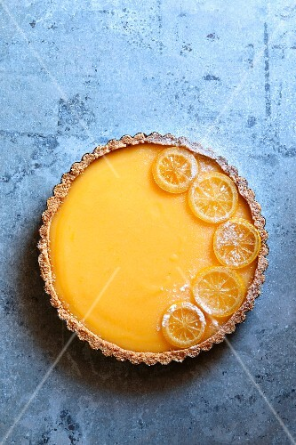 Classic lemon tart garnished with candied lemon slices