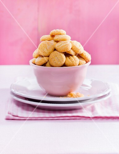 A pile of butter biscuits in a pink bowl