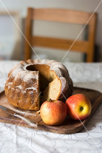Apple gugelhupf, sliced, on a wooden tray