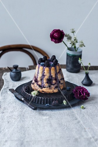 A gugelhupf with teff flour, chickpea flour, blueberries, blackberries, cashews, maple syrup and blueberry powder
