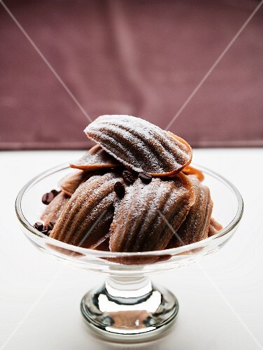 Mocha madeleines in a glass bowl
