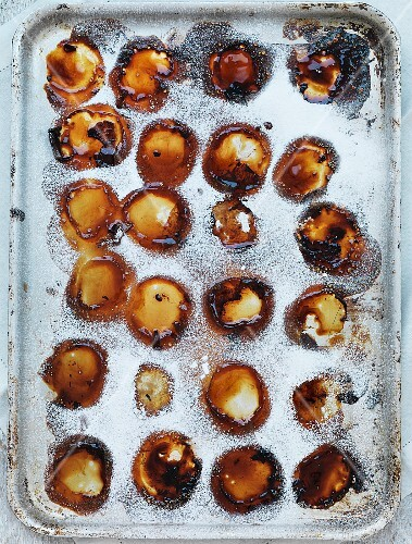 Leftover baked peaches on a baking tray