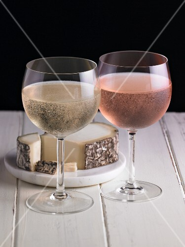 Cider and rosé cider in glasses served with cheese
