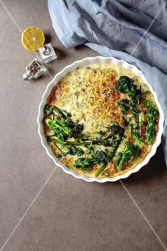 Vegetable quiche with broccoli and cheese in a white plate, Traditional French food