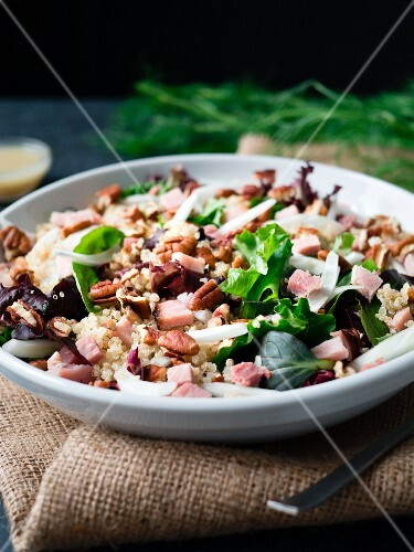 Ham, fennel and quinoa salad on burlap