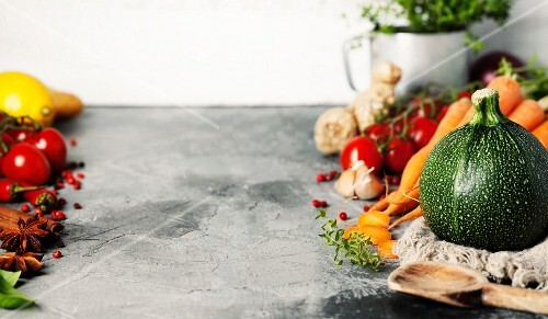 Fresh vegetables for cooking on rustic background