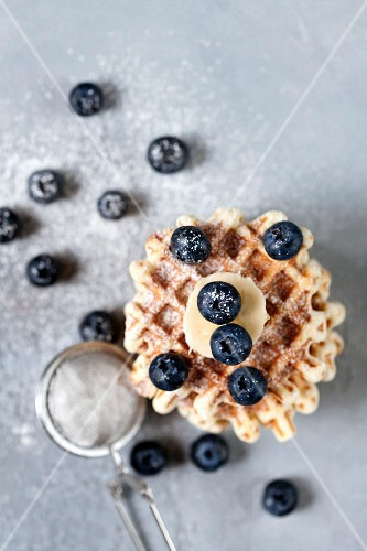 Waffles with banana and blueberry, dusted with powdered sugar