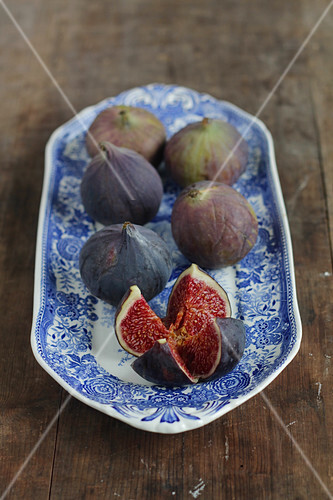 Six blue figs on a blue and white porcelain plate