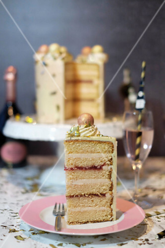 A New Year's Eve cake with champagne, sliced