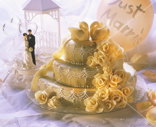 Three-tiered wedding cake with marzipan roses and swans (1)