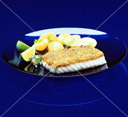 Cod fillet au gratin with potatoes on plate