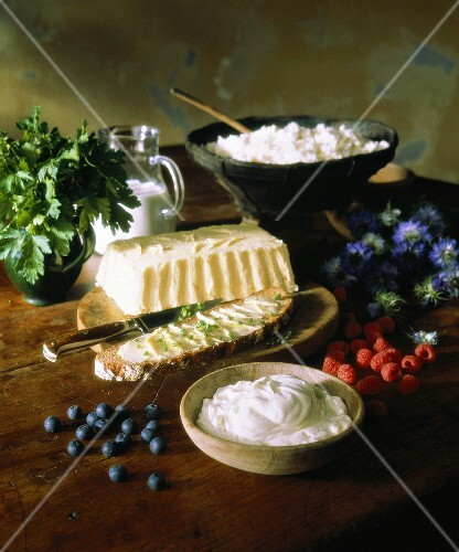 Various dairy products, berries and parsley