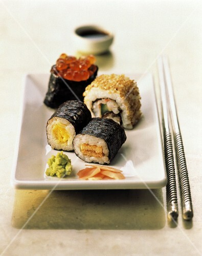 Assorted Sushi with Green Wasabi Paste on a Rectangular Plate