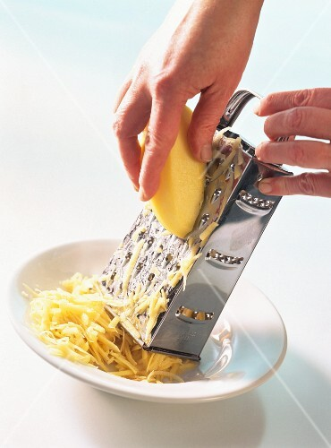 Grating raw potato with four sided grater
