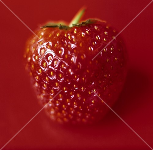 Strawberries on red background