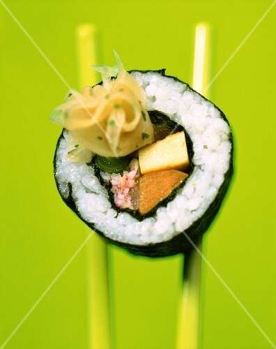 Maki-sushi with crabmeat, scrambled egg and tuna