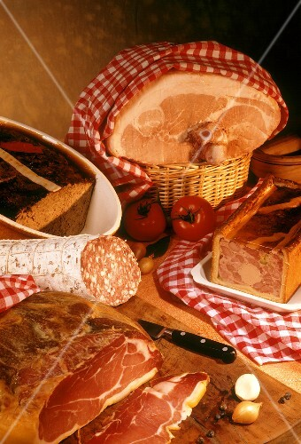 Still life with two French hams, sausage and pate