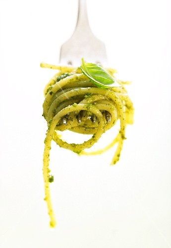 A forkful of spaghetti with pesto