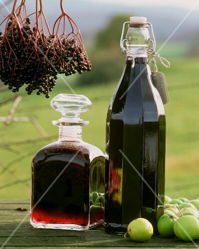 Elderberry liqueur and juice in bottles
