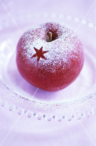 Christmas apple with icing sugar decoration