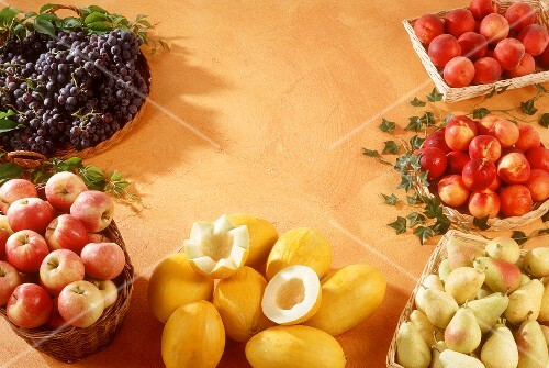 Assorted fruit grouped round edge of picture