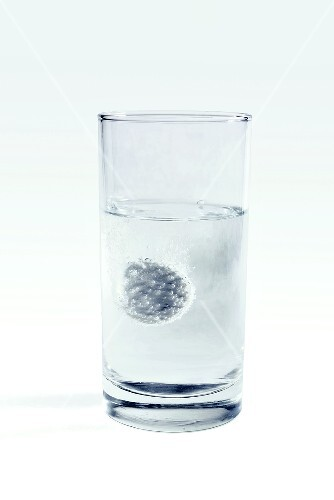 Soluble aspirin tablets in glass of water
