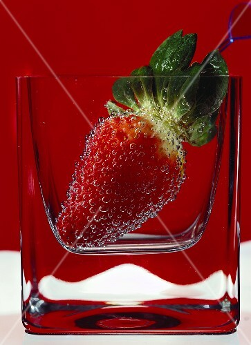 Strawberry in a glass of water