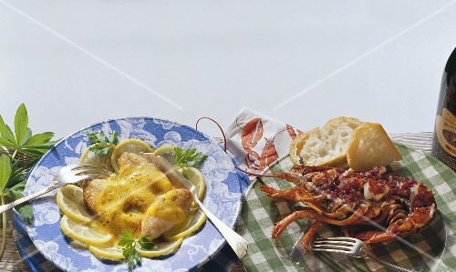 Fish with lemon sauce and baked lobster with white bread