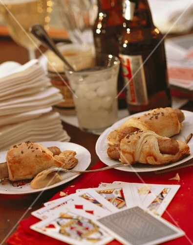 Party Table Scene with Pigs in a Blanket and Beer; Cards