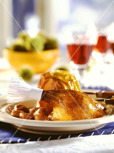 Christmas goose (leg with paper frill), baked apples, chestnuts