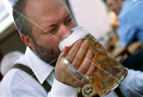 Man drinking a litre of beer at Oktoberfest