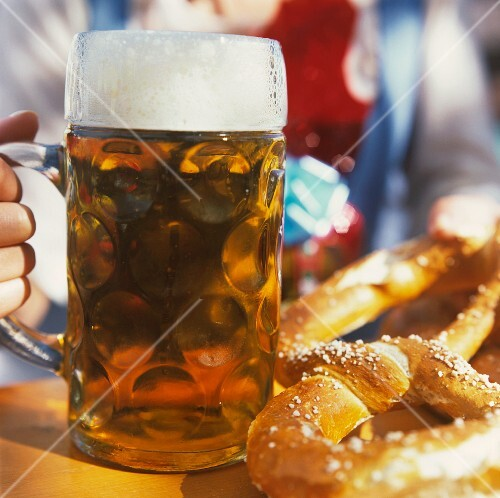 Tankard and two pretzels on table at Oktoberfest