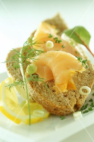 Open sandwich with salmon, spring onions and dill