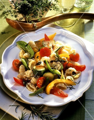 Pasta shells with summer vegetables and pumpkin seeds