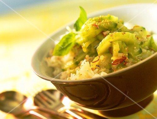 Cucumber salad with sesame and chili on rice