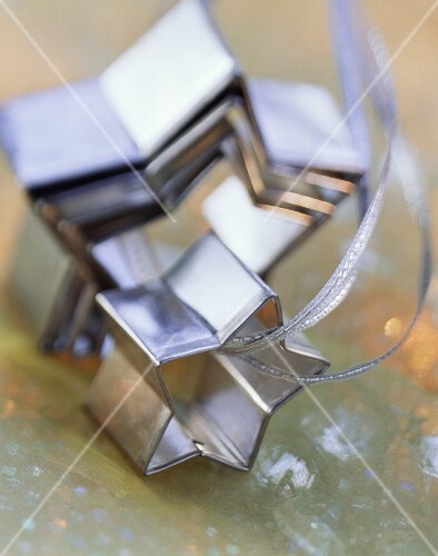Star-shaped biscuit cutter on silver ribbon