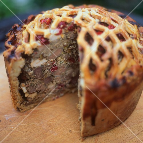 Venison pie with cranberries, a piece cut