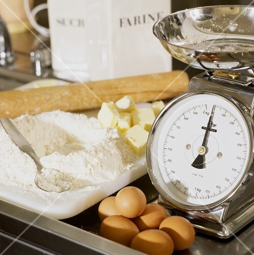 Baking ingredients (flour, butter, eggs) with scales