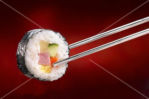 Maki-sushi with ham on chopsticks
