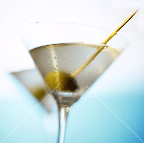 Martini with green olive and toothpick