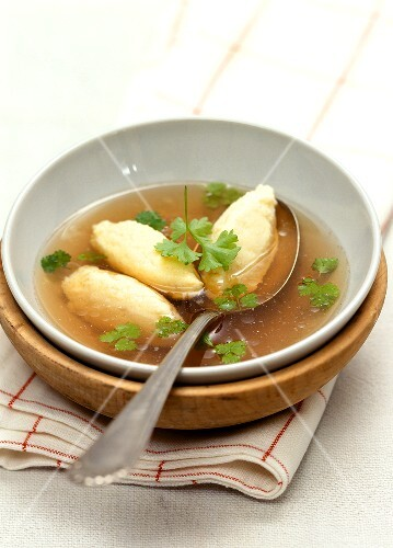 Semolina dumpling soup with parsley – StockFood